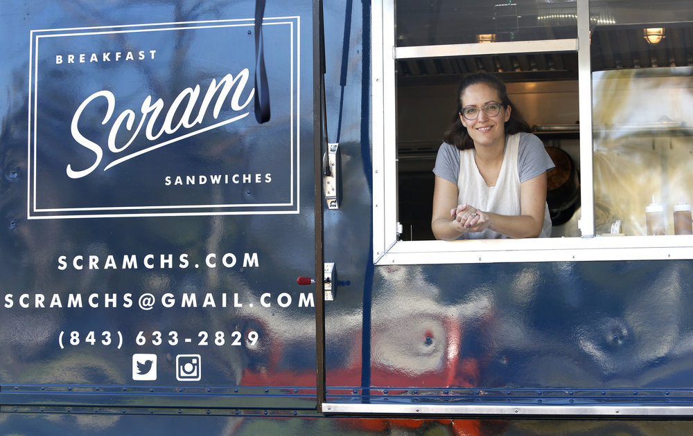 Melanie Durant sells egg filled puff pastries, breakfast sandwiches and other sweets at Scram breakfast food truck on Folly Road in Charleston, S.C.