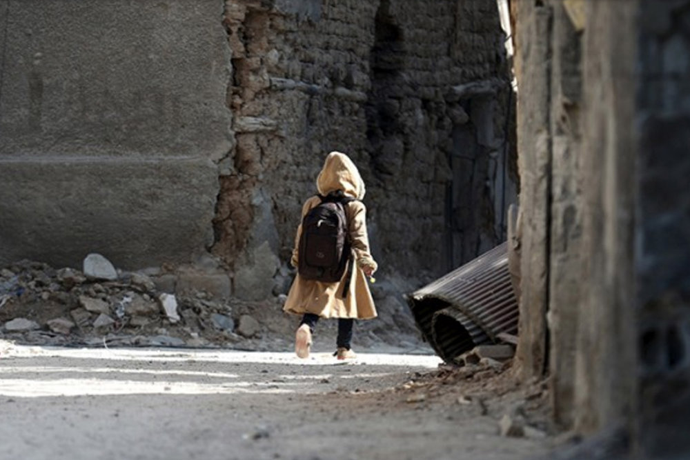 Syrian child with a school backpak-homepg.jpg