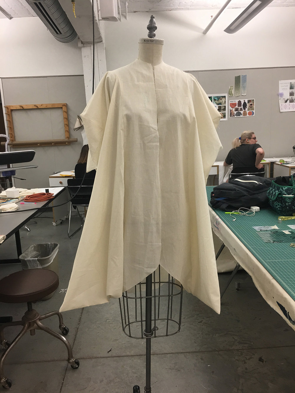 After deconstructing the original drape, I continued to alter the pattern on paper. Mock up above #3. Due to material, the pattern could only consist of straight lines.