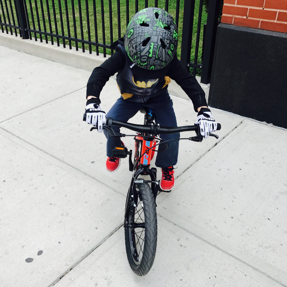 This is exactly the position you want your child in when they are learning to ride a bike. Wide, stable grips and a low chassis with manageable stand-over height.