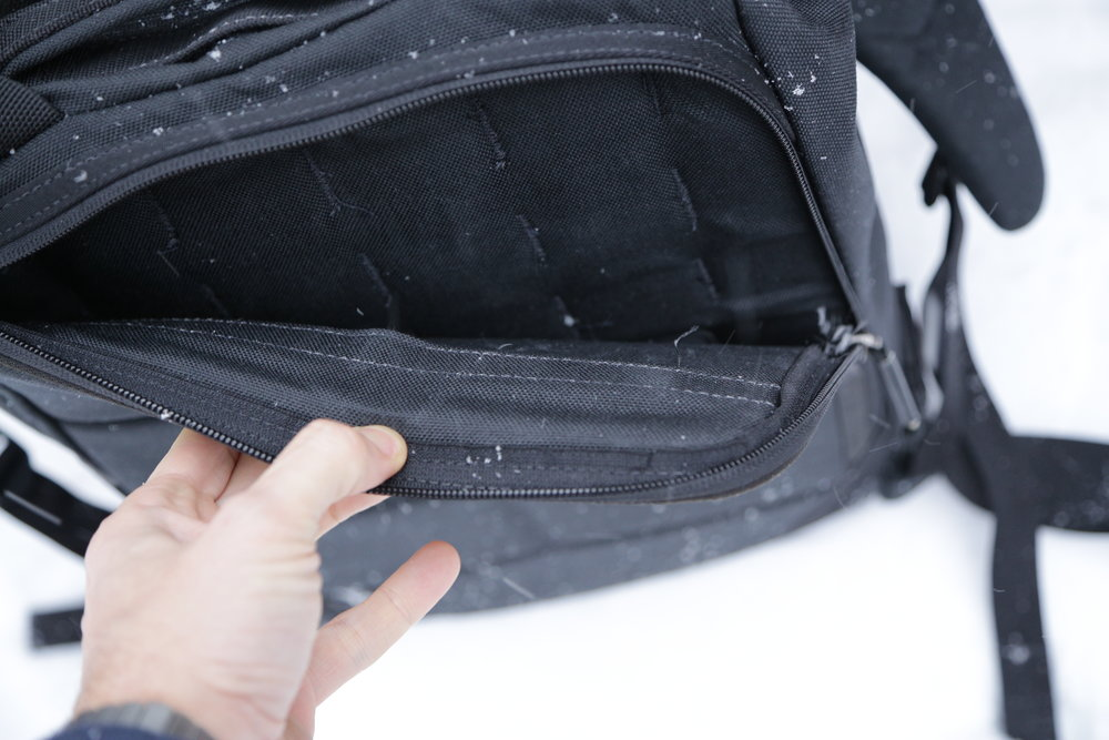 "A peek inside the ""bombproof"" laptop sleeve shows the molle from the internal back wall and the slip pocket from the stiffening sheet. This is one strong sleeve."