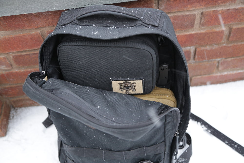 The GORUCK pouch is extremely sweet, and attaches securely to the molle on the back of the inside compartment. This also renders the molle useless for any other needs.