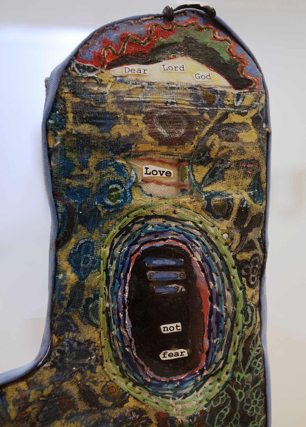 Prayer Paddle: Love Not Fear (detail) , mixed media, 15 by 13 ½ inches, 2007-2014.