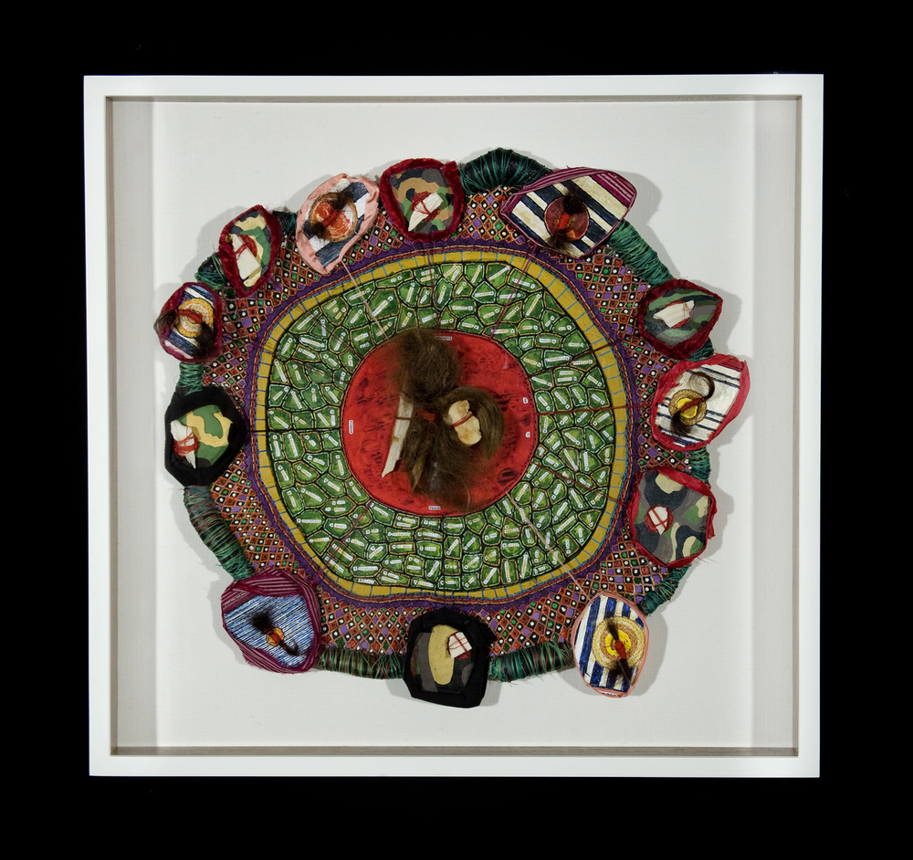 An Alphabet For A Holy Land , hand stitching, oil paint, collage, human hair and cow bone on paper and cloth, 17 inch diameter, 2011.