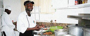 Chef 'Oliver' prepares conch fritters, a special at Villa Juanita.