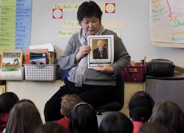 Third grade teacher Joanne Kataoka tells her students about her uncle, Fred Korematsu, two days before California's first Fred Korematsu Day on January 30, 2011. Kataoka received a free teaching kit from the Korematsu Institute. Photo taken at Lorenzo Manor elementary school in San Lorenzo, CA. Photo by Paul Chinn/San Francisco Chronicle/Corbis