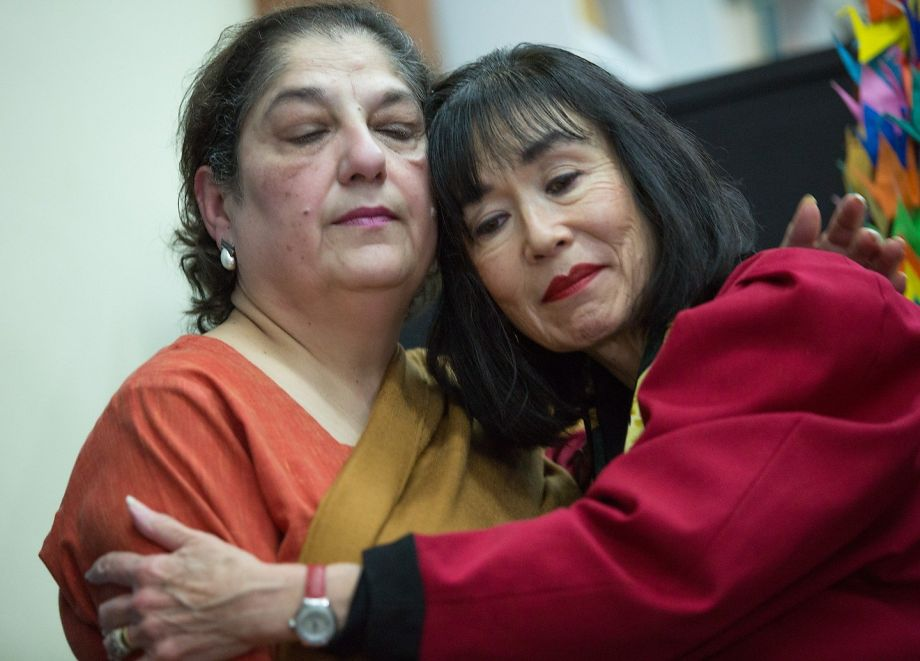 Photo: Santiago Mejia, Special to The Chronicle Karen Korematsu (right), comforts Samina Sundas of the American Muslim Voice Foundation at a news conference.