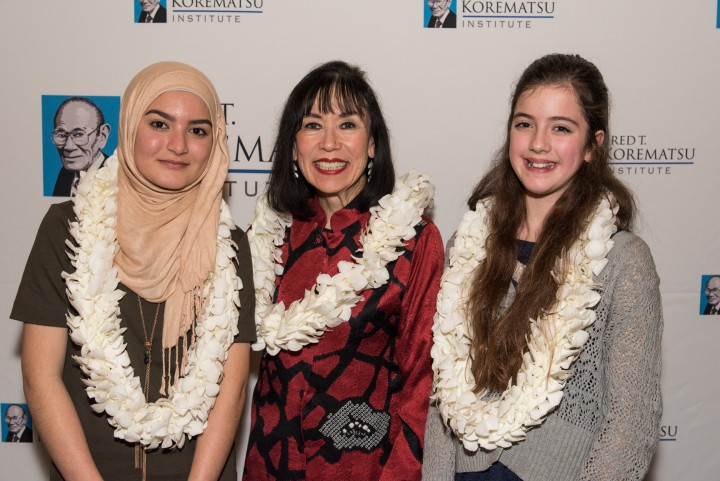 Fred T. Korematsu Middle School speech winners Madeeha Khan, left, and Vivien Wallis, right, with Karen Korematsu.