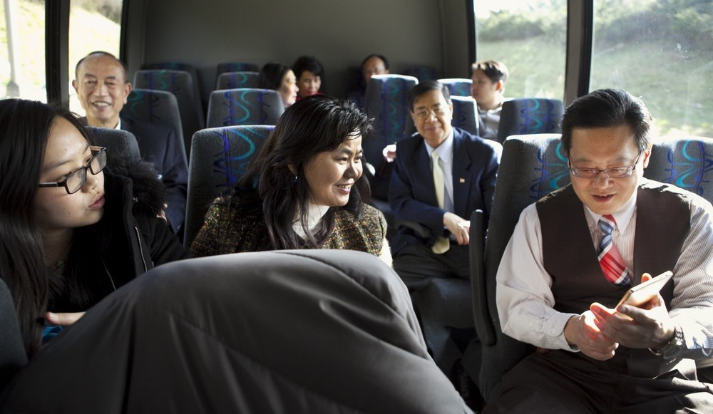 Members of a coalition of Asian Americans ride a bus on the way to lunch in Richmond after visiting with state legislators. The group is trying to enhance the political presence and power of their communities. (Timothy C. Wright/For the Washington Post)