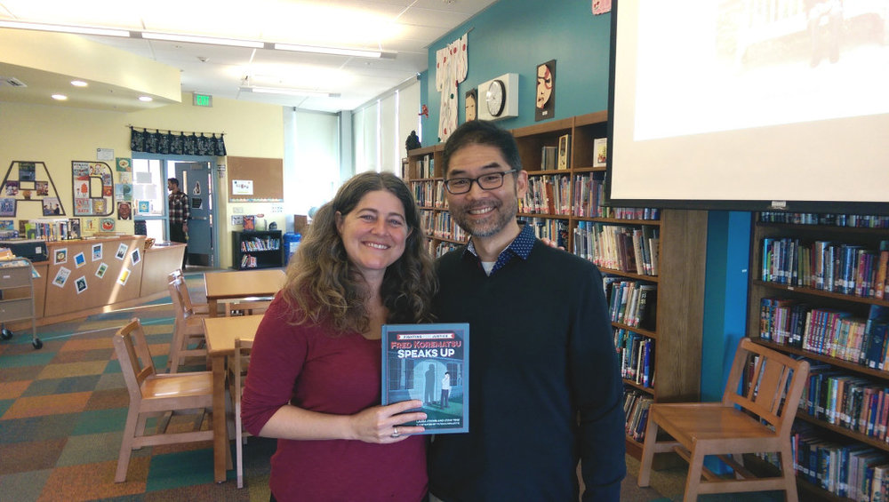 "Laura Atkins and Stan Yogi are the authors of a new children's book on civil rights icon Fred Korematsu titled ""Fred Korematsu Speaks Up."" Korematsu is known for fighting the World War II internment of Japanese Americans. The authors are posing with a copy of the book at the library of Jefferson Elementary School in Berkeley, where they recently spoke to students. A book launch is scheduled from 2 to 4 p.m. Feb. 4 at J-Sei center, 1285 66th St., Emeryville. (Courtesy of Adoria Williams)"