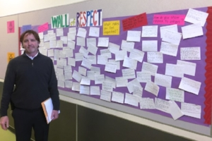 Principal Matt Burnham stands by the Wall of Respect at Korematsu Middle School in El Cerrito on Jan. 30. Tom Lochner