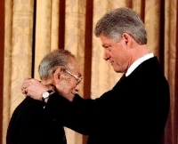 FILE — President Clinton presents Fred Korematsu with a Presidential Medal of Freedom during a ceremony at the White House Thursday Jan. 15, 1998. (AP Photo/Dennis Cook)