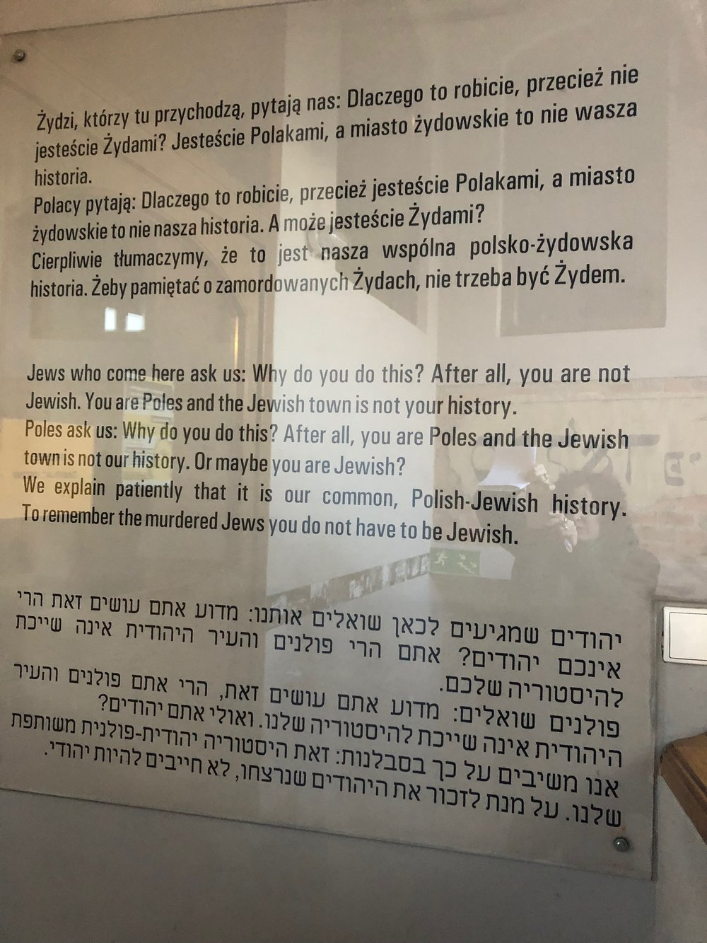"""Me taking a picture of one of the signs at the entrance to Brama Grodzka-Teatr NN. (Elsewhere I discuss the use of the term, """"Pole"""" to mean non-Jewish Pole. I try to avoid it because it denies the fact that Jews were and are Poles as well)."""