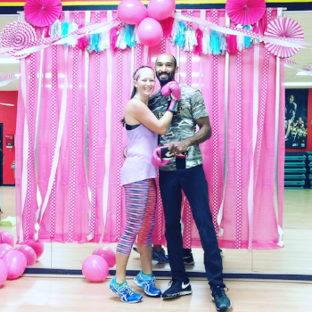 My husband and I at a COMBAT BREAST CANCER class wearing my  Prana  leggings!