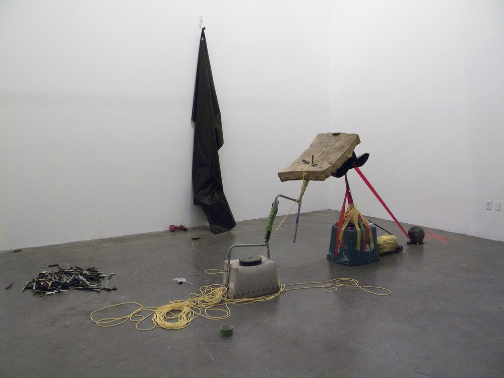 Two Teams Of Five Members Each, While Blindfolded, Work To Build An Arch With Whatever Materials Are On Hand In Under Ten Minutes, 2012, Knives, nylon rope, duct tape, 2 barbell weights, 3 bowling balls, cordless drill, plastic curtain, couch cushion, zip ties (click here for a larger image)