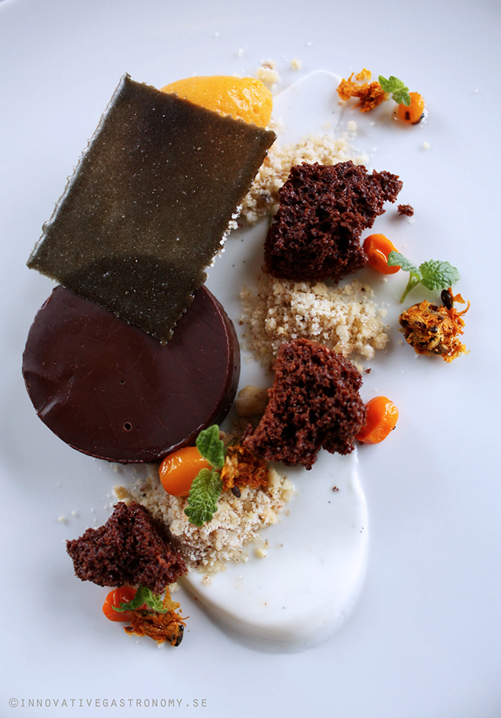 Chocolate ganache with sea buckthorn sorbé, dried chocolate mousse and liquorice