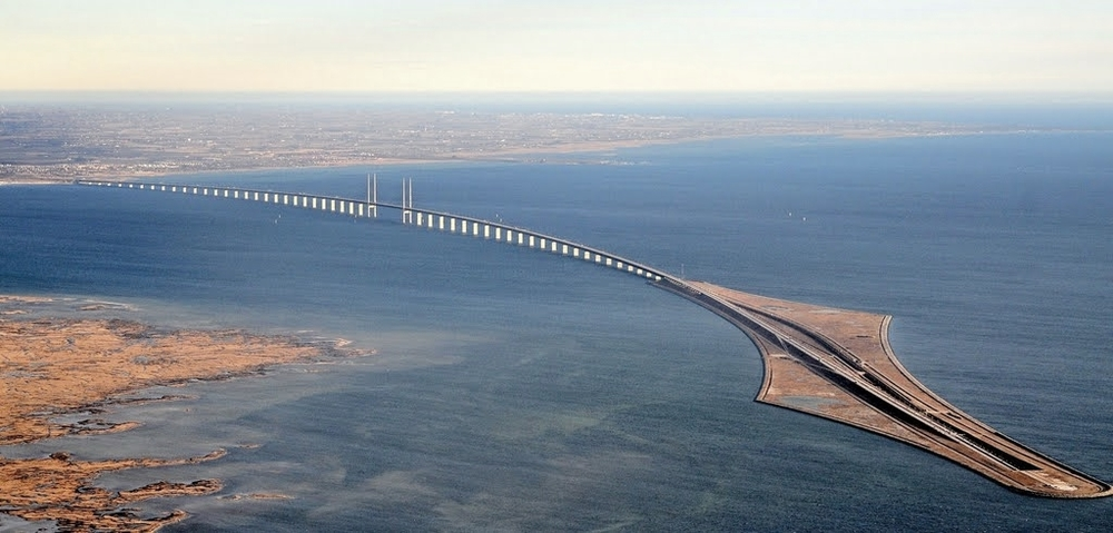 Öresundsbron begins/ends in a rather dramatic way – from over water to under water.   photo source found  here