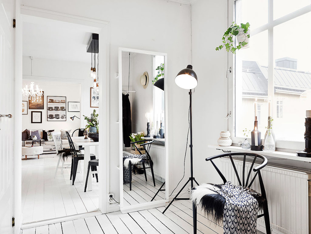 White exposed floorboards are a real modern Scandinavian classic. Try off-setting with warm rugs or throws - the Danes call it 'hygge' - which roughly translates as 'cosy'!    Image source found  here