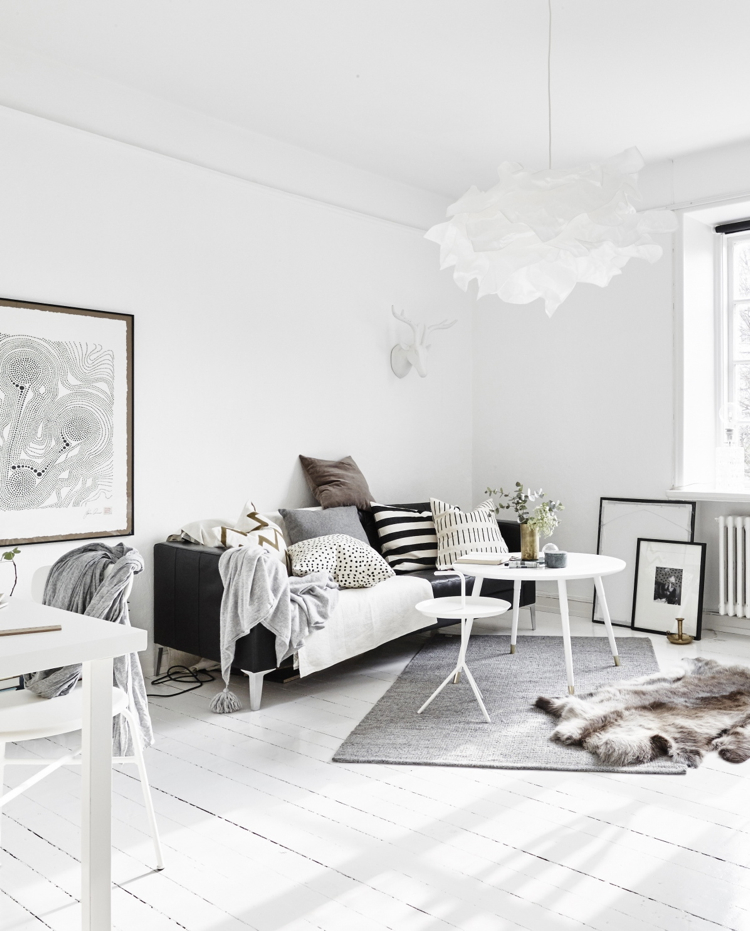 This is a great example of a more subtle, relaxed monochrome style. Not all Scandi design has to cost a fortune - that beautiful ceiling light is from Ikea!    Image source found  here