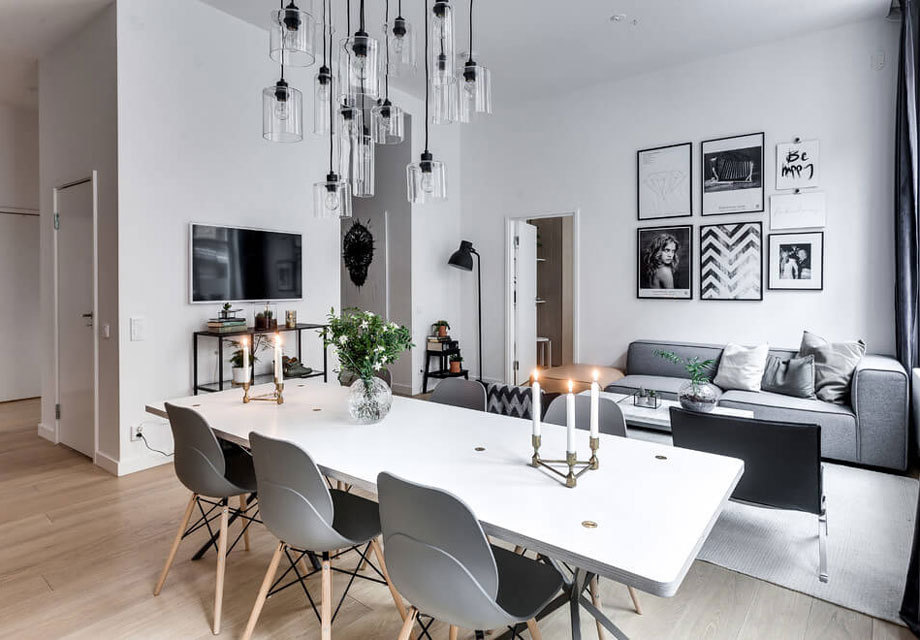 Try clustering pictures or wall images for maximum impact - particularly if you are lucky enough to have nice high ceilings like this gorgeous apartment!   Image source found  here