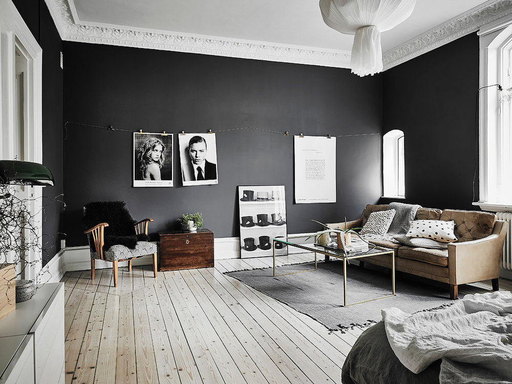 Dramatic contrast with dark wall colour and white skirting boards and ceiling.