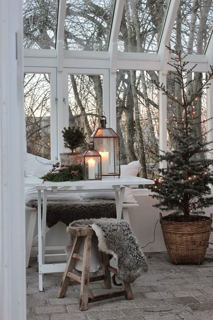Warm lighting to counter the cold, dark evenings outside - 'hygge' at its finest!   Image source