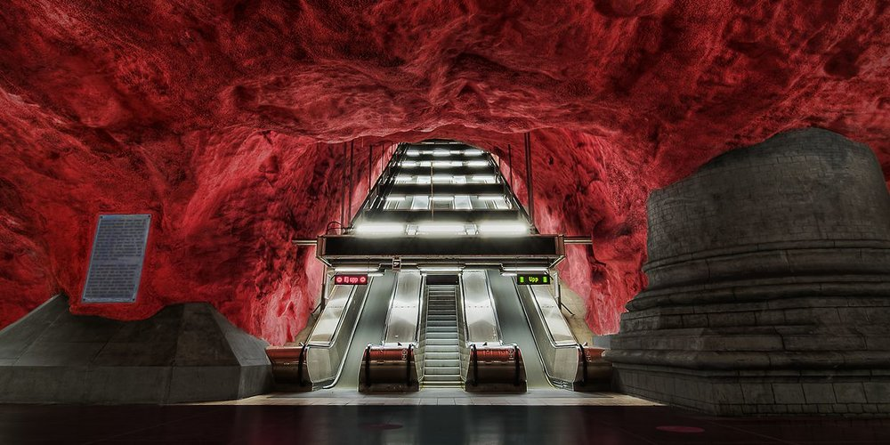 Spectacular blood red rock ceiling at Solna Centralen station. Photo credit: Flickr.com/ Tobias Lindman)