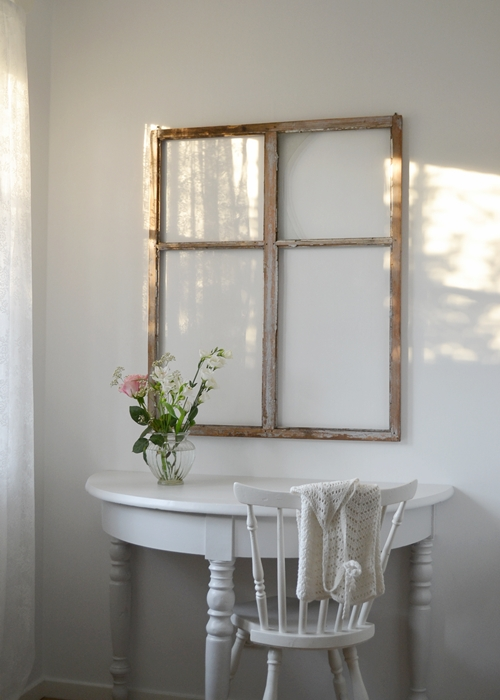 A wooden window frame without glass makes for an usual but truly wonderful feature, adding an antique feel to your white country space.        Image source