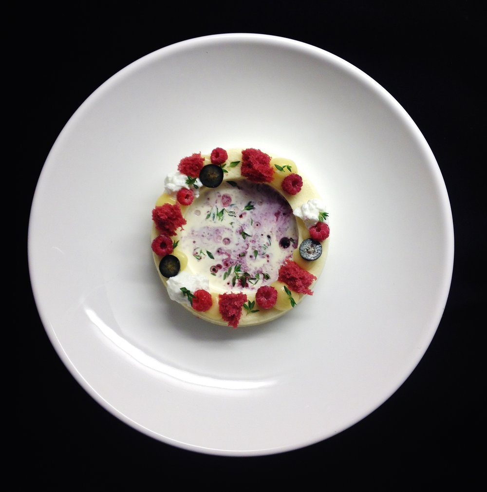 Forest blueberries and raspberries with thyme infused cream