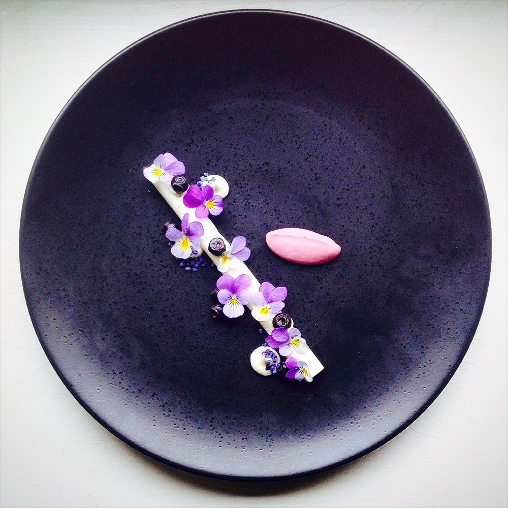 Forest blueberries, yogurt and violets.