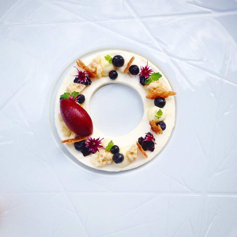 Yogurt, blueberries, rice and elderflower.