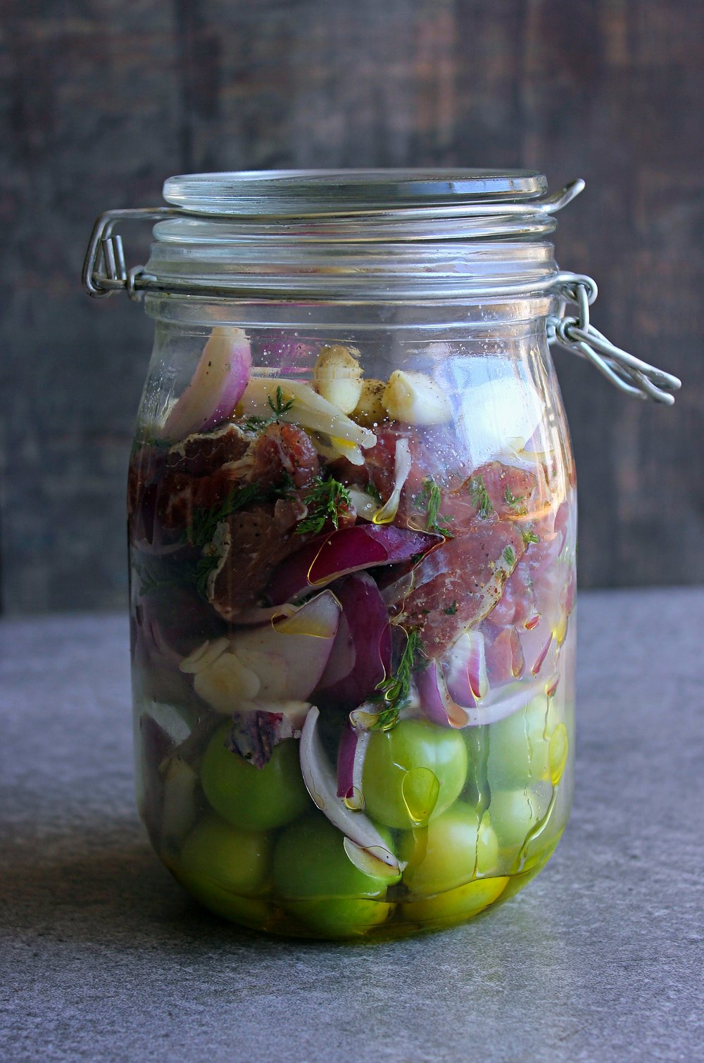 """This is one of my favourites, so simple and yet so delicious! It's a jar with mirabelle plums, garlic, onion, beef and yarrow, baked in the oven at low temperatures."""