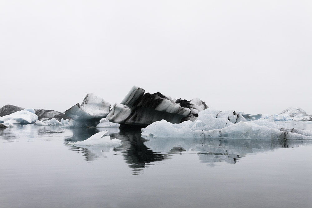 """Jökulsárlón, also one of my favourite spots. It is perfect when you manage to avoid the crowds (either at 4am in summer or in one of the little 'side beaches' away from the main parking area in winter), the water stands almost still and you just here the slow groans of the icebergs crushing into each other."""