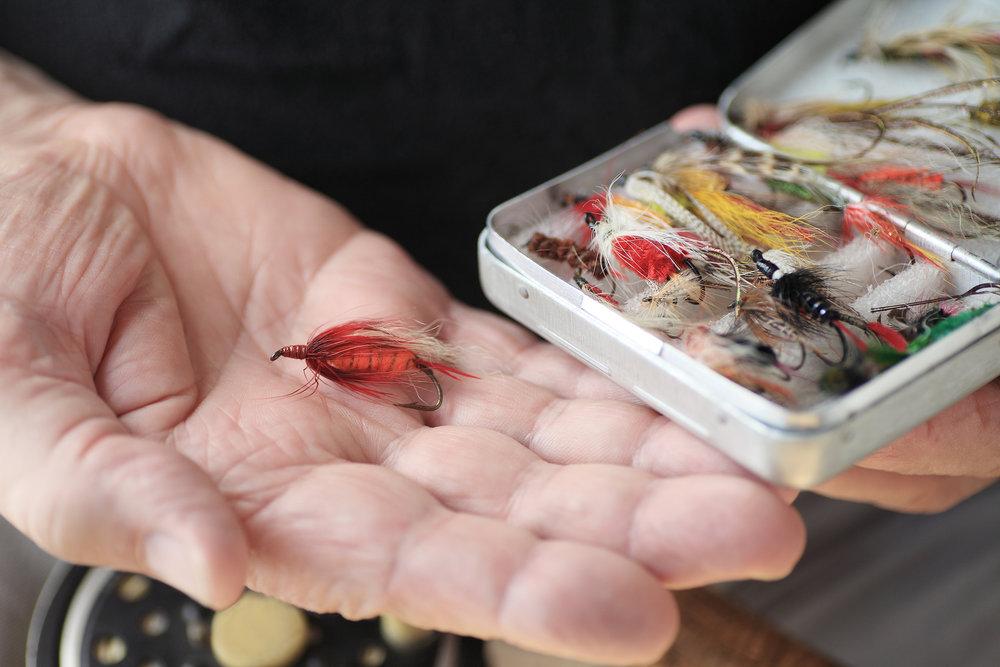 bigstock-Artificial-fishing-flies-in-bo-97244102.jpg