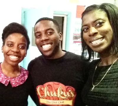 Ifeyinwa and Emeka grinning with Christine Ohuruogu