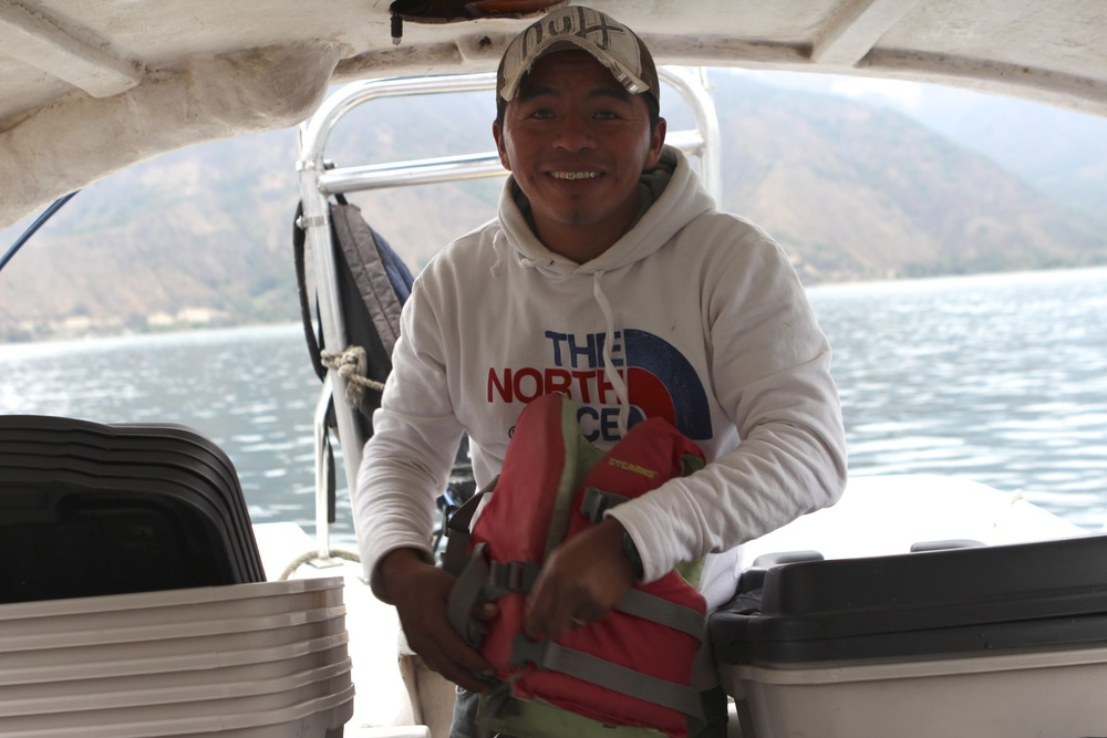 Daniel is our regular boat driver for trips across the lake, and he takes special care for all of us, including our bins of medical supplies for transport, and little life jackets for little people.  He's just a dad too, trying to make an honest living.