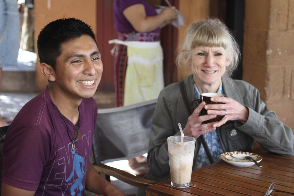 Miguel, our oldest scholarship student, with Barb (married to Ron), enjoying good Guatemalan coffee.