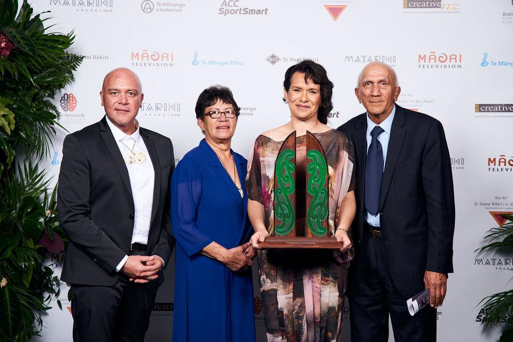 Ropata-Taylor-Lynne-Stafford-Kerensa-Johnston-Rore-Stafford-accepting-award-July-2018.jpg