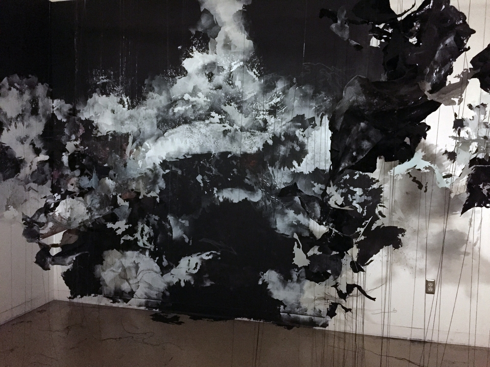 "Przeswity, rozwidla (""It grows and bifurcates until the whole"")  2015, paint, Mylar, thread, felt, pins, approx. 10'h x 15'w x 10'd"