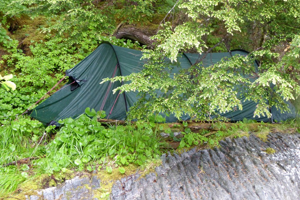 It was about a 10 foot drop around the tent, plus with the rain the rocks were quite slippery. Not the best tent pitching job, but it worked!