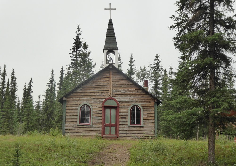 The First Nation cemetery is still being used today. The spirit houses are brightly painted,