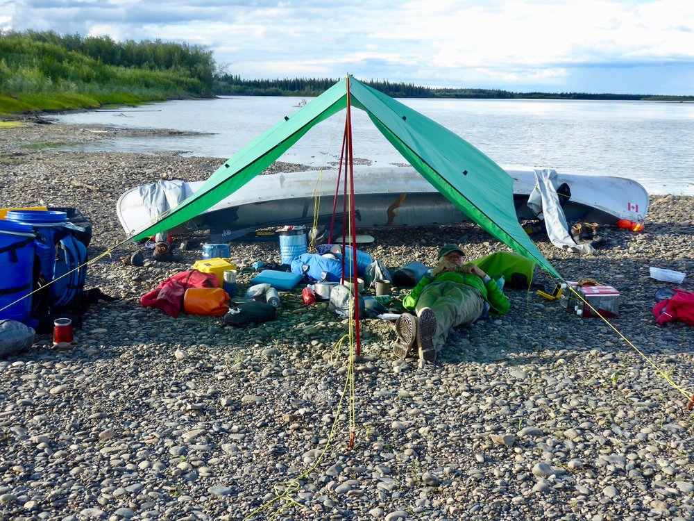We are now using our canoe as the anchor for one end of the tarp. We like this method. Even though there are no bear tracks around, we still try to set the tent away from the kitchen area.