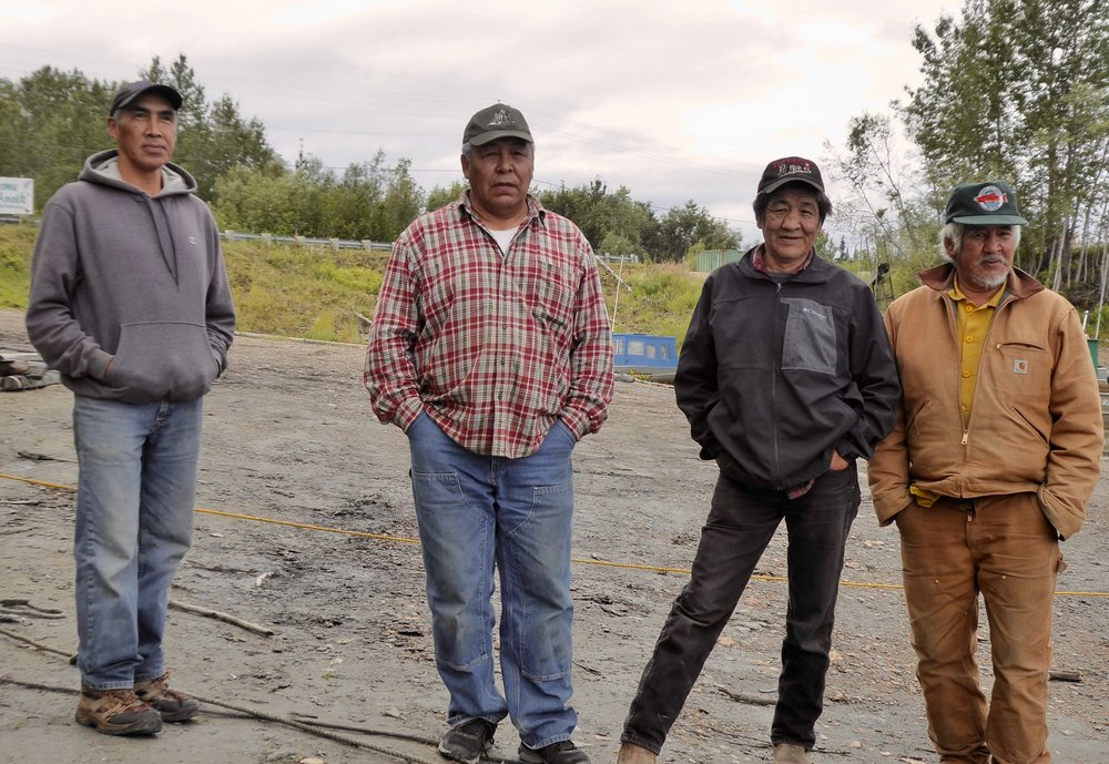 The man in the plaid shirt is from Nulato and ran the Iditarod in the 80's. He is here for a potlatch that is being held here for a memorial for his niece's baby. The two men to his right have lived here their entire lives.. The man to his left is from a distant village. We take a short walk up the bank. An old church and boarding school is boarded up.