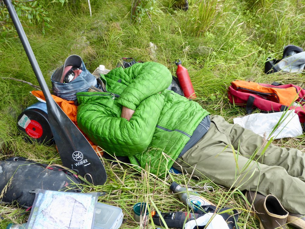 Sleep is good!  This is one of the shortest paddles of the trip. Miles traveled 15 August 21 The beavers were quite active last night and the wind continued to blow hard. Not a good night for sleeping till about 4 when one could sense the wind had calmed. I was ready to get up, but it was still dark at 6. The seasons are changing. Last night we could see the lights of Pitkas Point. For some reason we were able to get cell service. It was enough to load emails and get an idea of when the eclipse was going to occur. It would only be a partial one, but still we would be aware that it was happening. It was very foggy this morning. We could not see the other side of the river. We also decided that we were not going to visit St. Marys. It would have added 6 miles to our journey 3 of which would have been paddling up the Andreafsky River. Today was starting out with flat water conditions and we wanted to take advantages of it. We started out by hugging the shore as that was the only thing we could see. We eventually realized that we were crossing the Andreafsky River.  The fog was lifting and Canada geese were hanging out on the shore.