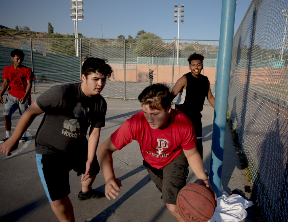 A group plays basketball in Gallup, New Mexico.