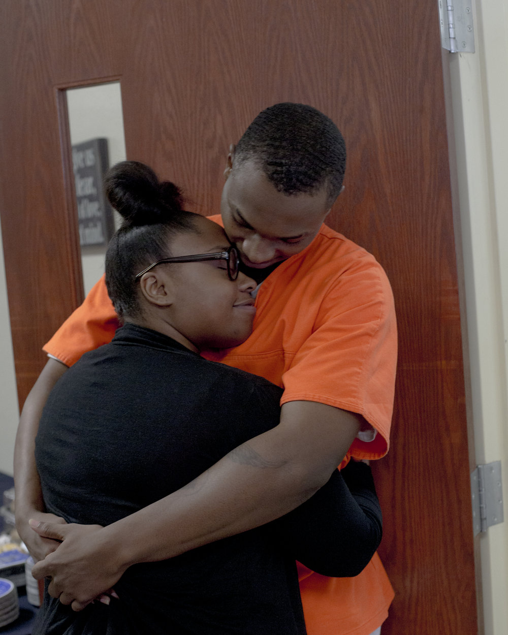 Bianca Hunter and Adesio Barnes embrace at Dick Conners Correctional Center in Hominy, Oklahoma after Barnes graduated with an associates degree. The two are dating after knowing each other for more than 10 years.