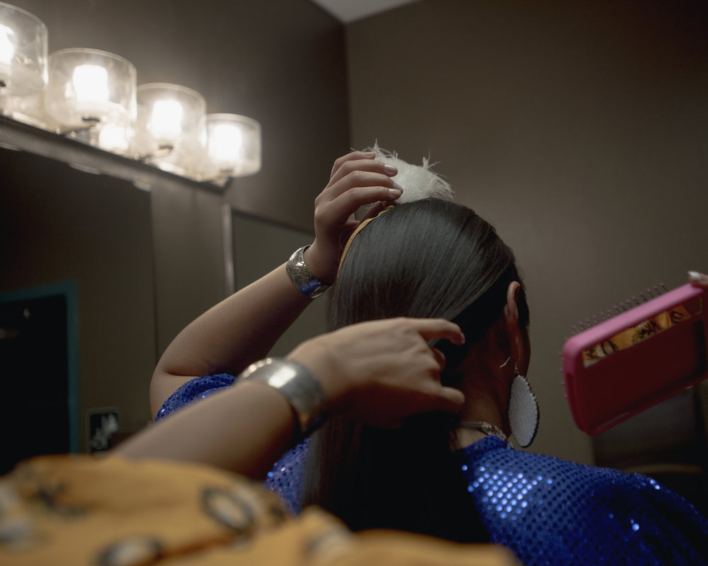Ashley Nilianh Susan, Miss Native American USA, brushes her sister Taylor Tailbi Denzhoone Susan's hair in Gallup, New Mexico.