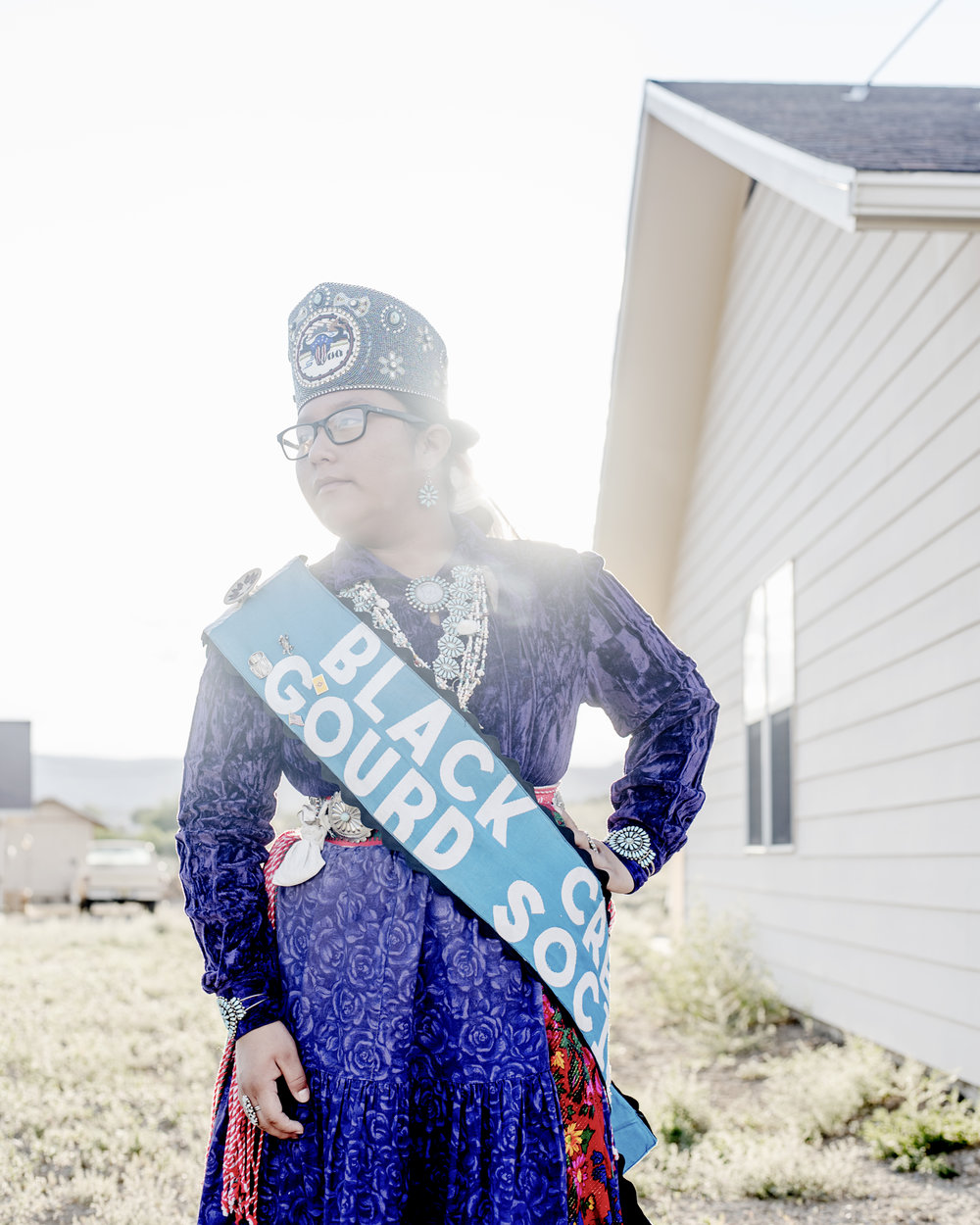 """Taya Tom in her home in Nakaibito, New Mexico. """"I wasn't traditional when I was small, but I learned about my culture and how to respect it,"""" she said."""