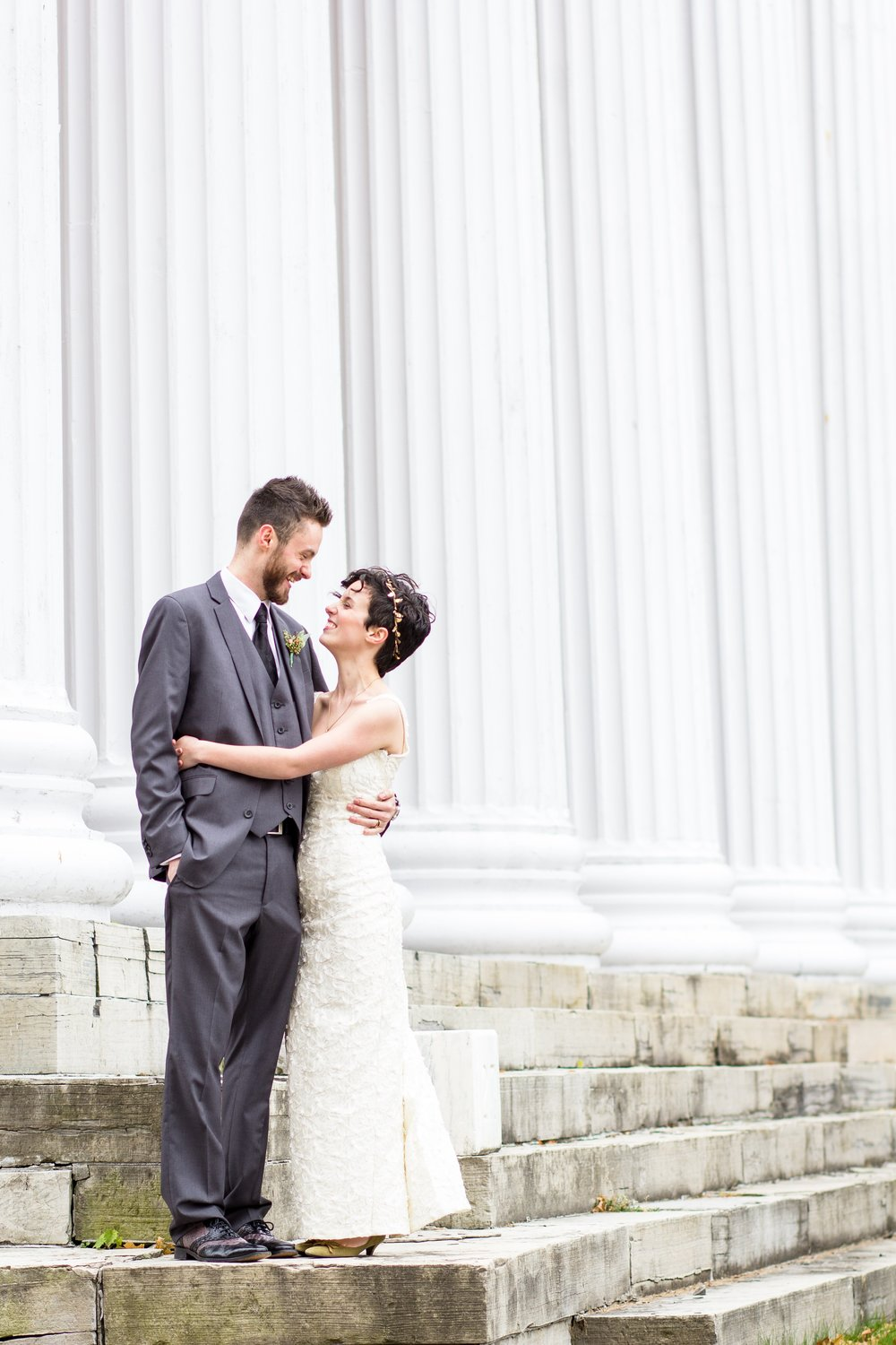 bride-and-groom-stone-columns-rochester-ny.jpg