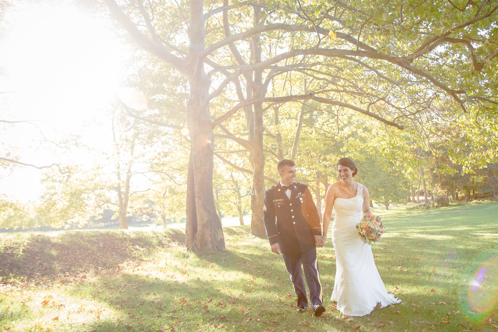 bride-and-groom-walking-sunshine.jpg